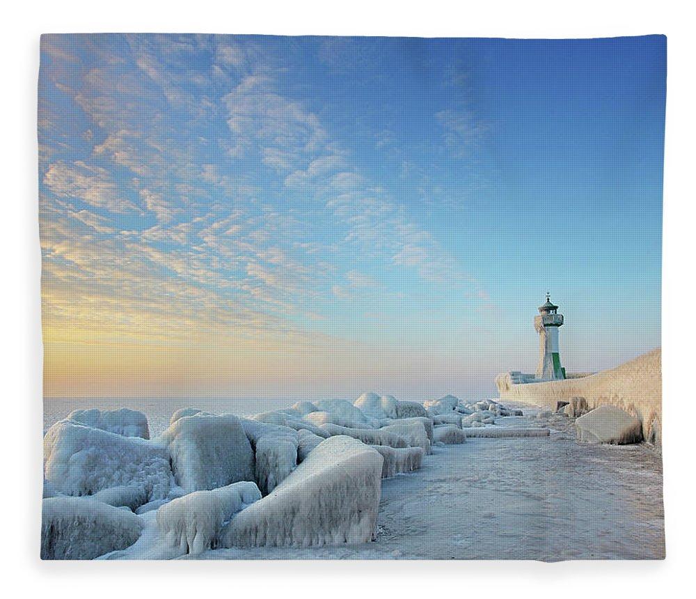 Dawn Fleece Blanket featuring the photograph Frozen Lighthouse by Sandra Kreuzinger