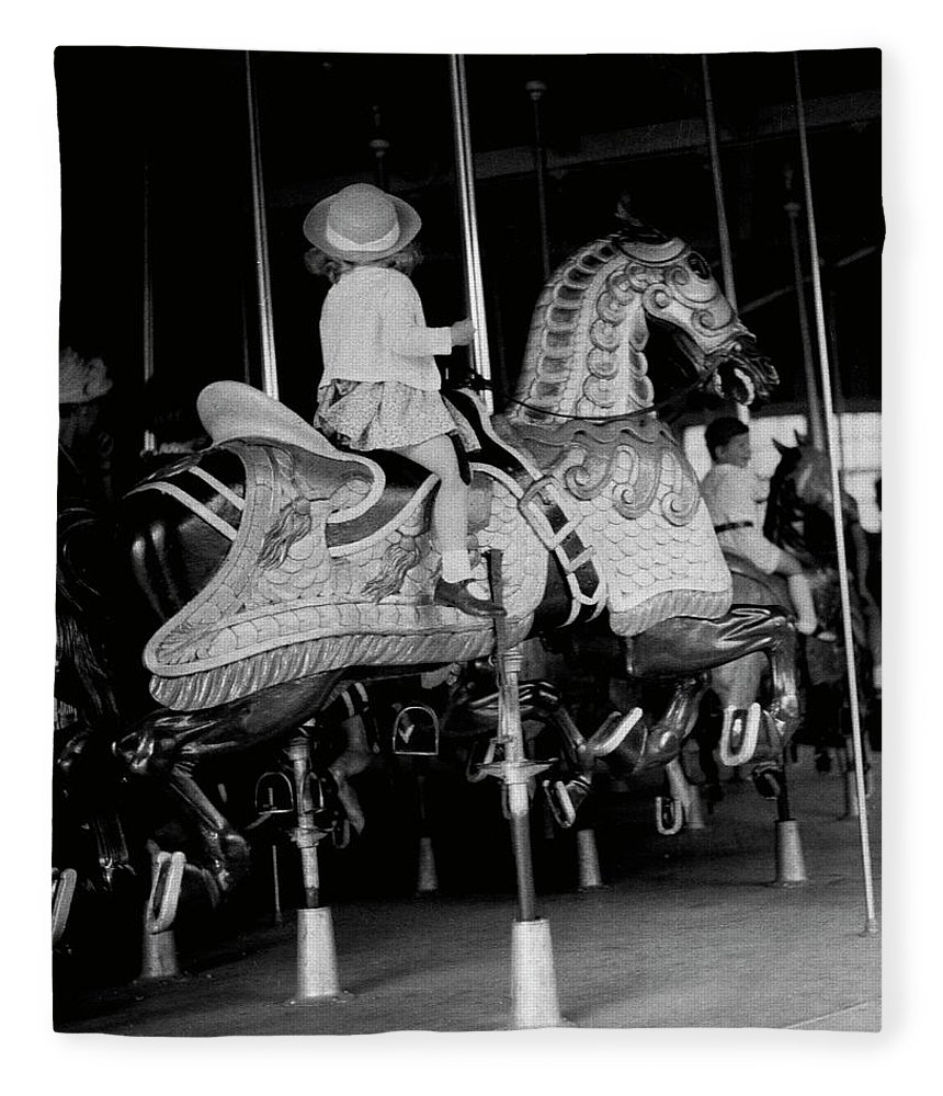 Child Fleece Blanket featuring the photograph Girl Riding A Carousel by George Marks