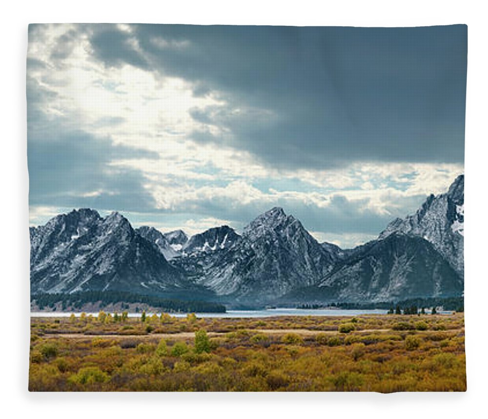 Scenics Fleece Blanket featuring the photograph Grand Tetons In Dramatic Light by Ed Freeman