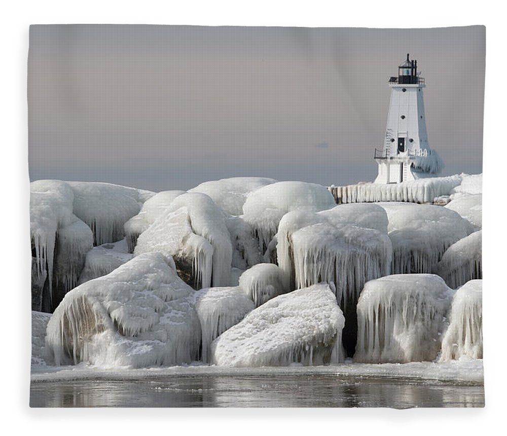 Water's Edge Fleece Blanket featuring the photograph Great Lakes Lighthouse With Ice Covered by Jskiba