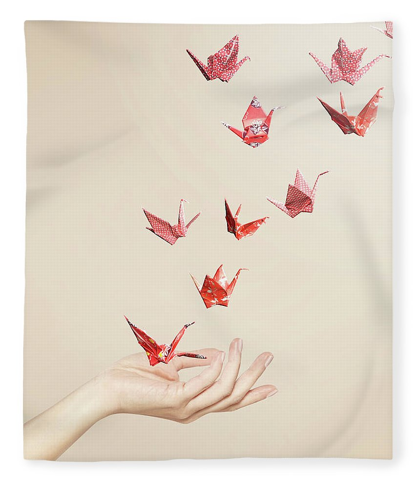People Fleece Blanket featuring the photograph Group Of Red Origami Cranes Flying Away by Paper Boat Creative