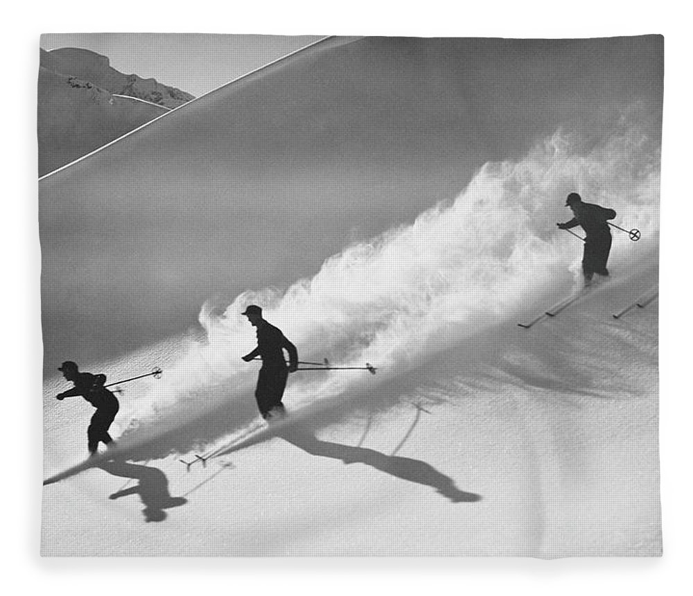 Skiing Fleece Blanket featuring the photograph Group Of Skiers Descending Alpine by H. Armstrong Roberts