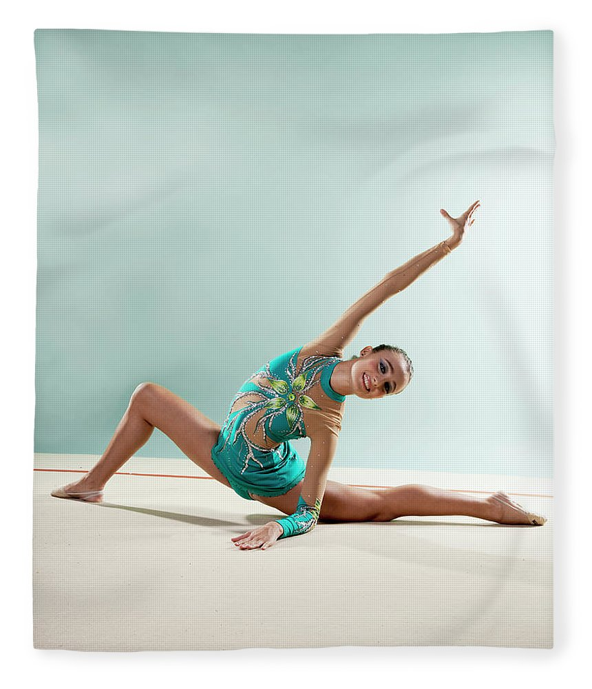 Human Arm Fleece Blanket featuring the photograph Gymnast, Smiling, Bending Backwards by Emma Innocenti