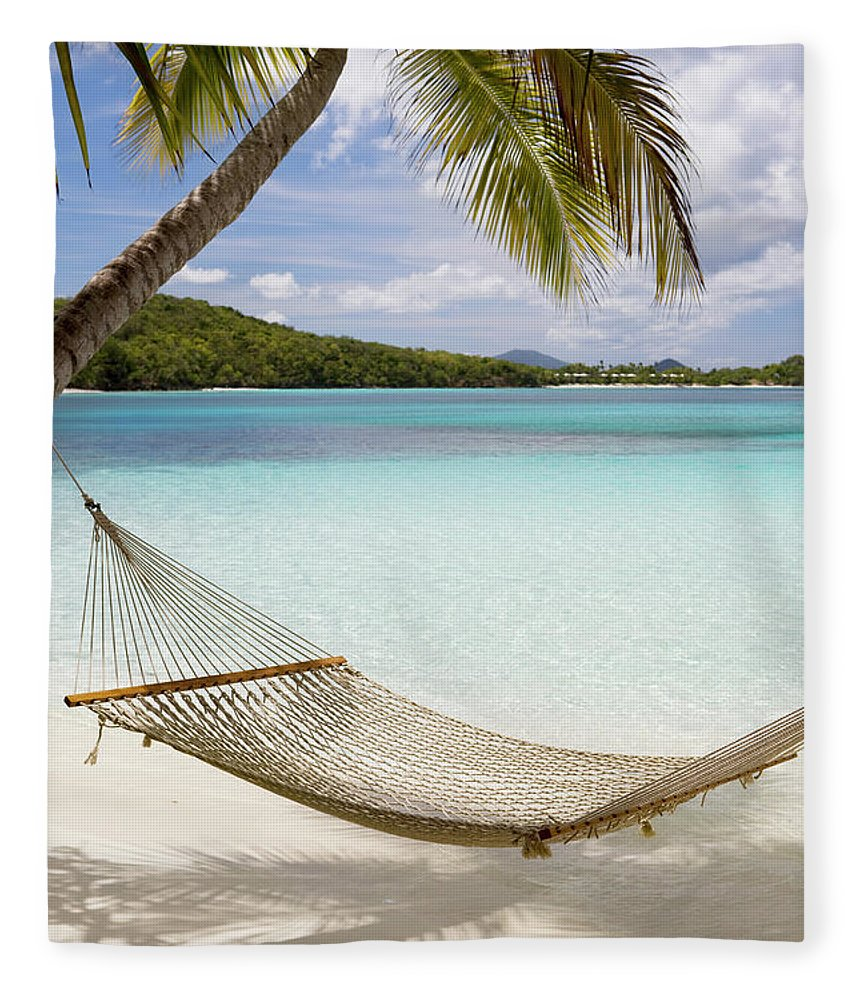 Water's Edge Fleece Blanket featuring the photograph Hammock Hung On Palm Trees On A by Cdwheatley