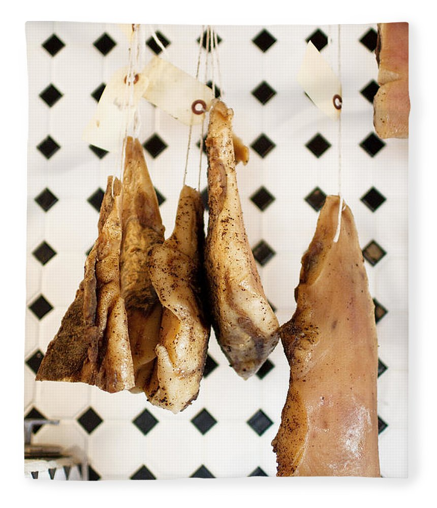 Hanging Fleece Blanket featuring the photograph Hanging Cured Pig At La Boucherie by Charity Burggraaf
