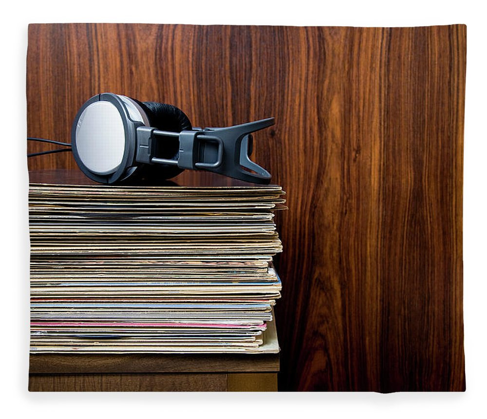 Technology Fleece Blanket featuring the photograph Headphones Laying On Stack Of Vinyl by Steven Errico