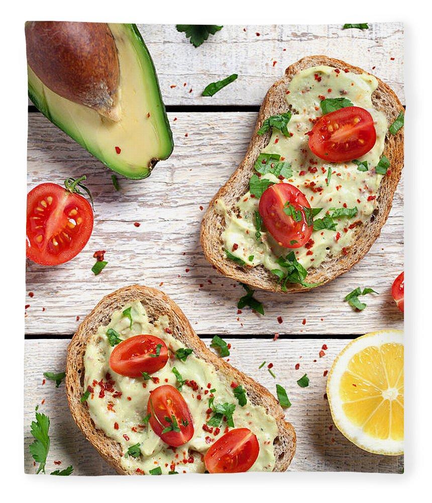 Breakfast Fleece Blanket featuring the photograph Healthy Whole Grain Bread With Avocado by Barcin