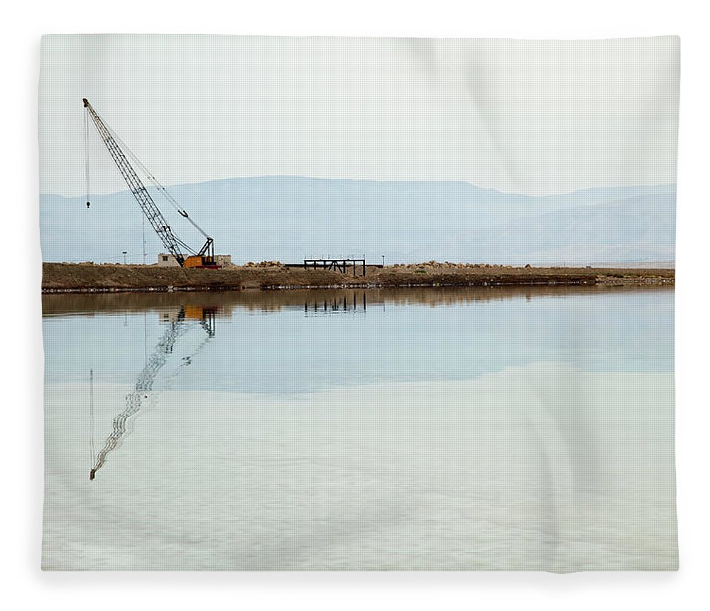 Working Fleece Blanket featuring the photograph Heavy Machinery At The Dead Sea by Eldadcarin