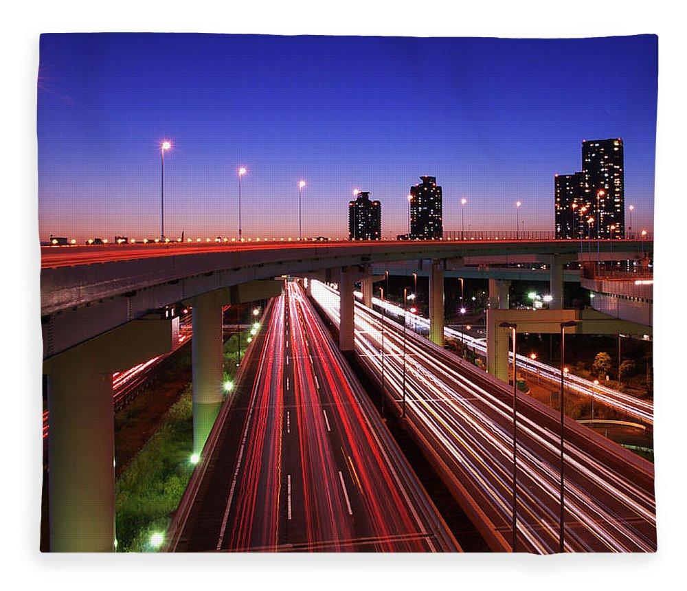 Two Lane Highway Fleece Blanket featuring the photograph Highway At Night by Takuya Igarashi