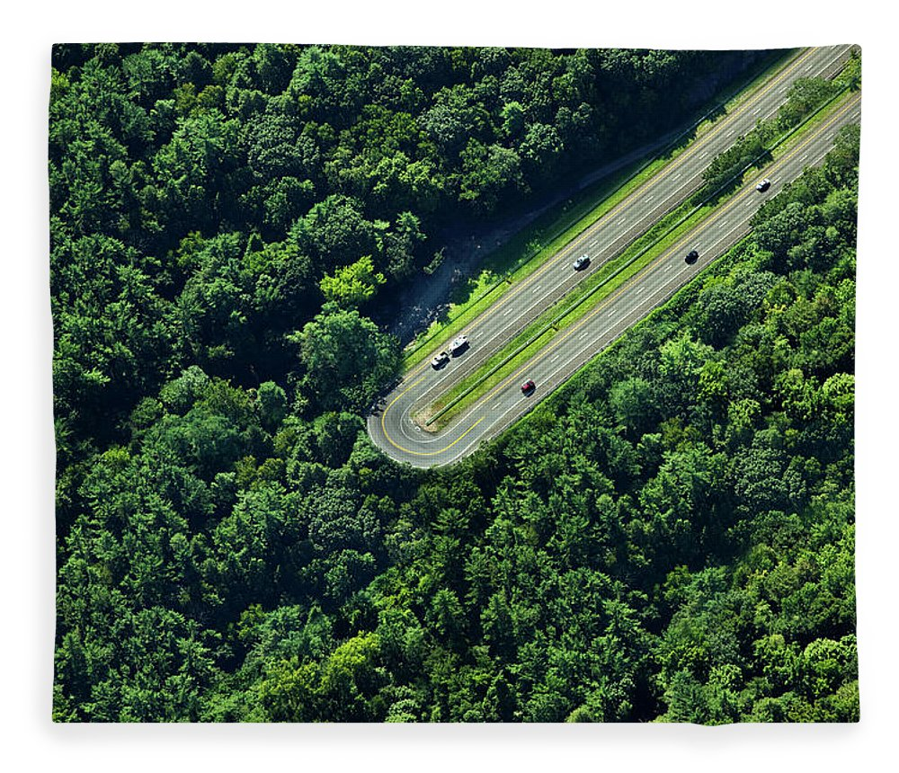 The End Fleece Blanket featuring the photograph Highway U-turn In Forest by Thomas Jackson