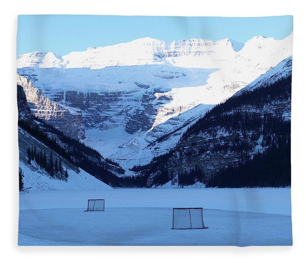 Scenics Fleece Blanket featuring the photograph Hockey Net On Frozen Lake by Ascent/pks Media Inc.