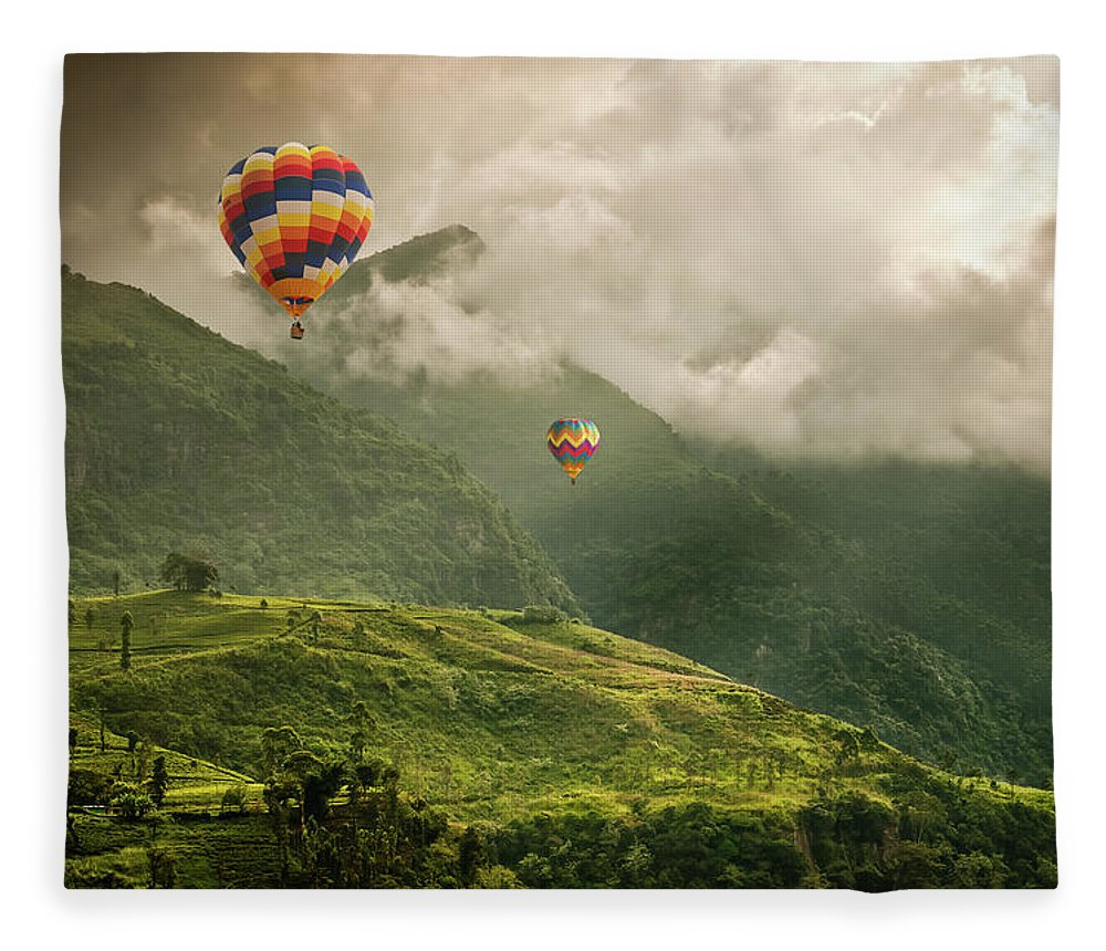 Tranquility Fleece Blanket featuring the photograph Hot Air Balloons Over Tea Plantations by Nicolo Sertorio