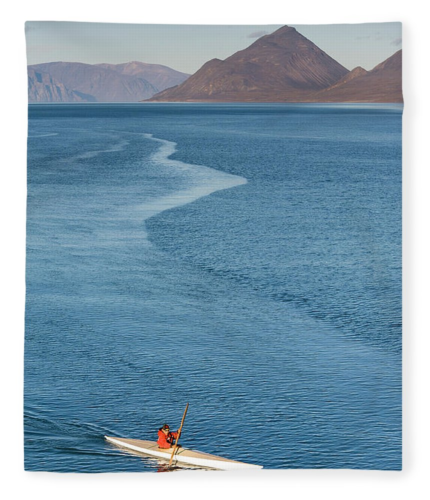 People Fleece Blanket featuring the photograph Inuit Man Paddling Traditionally Shaped by Andrew Peacock