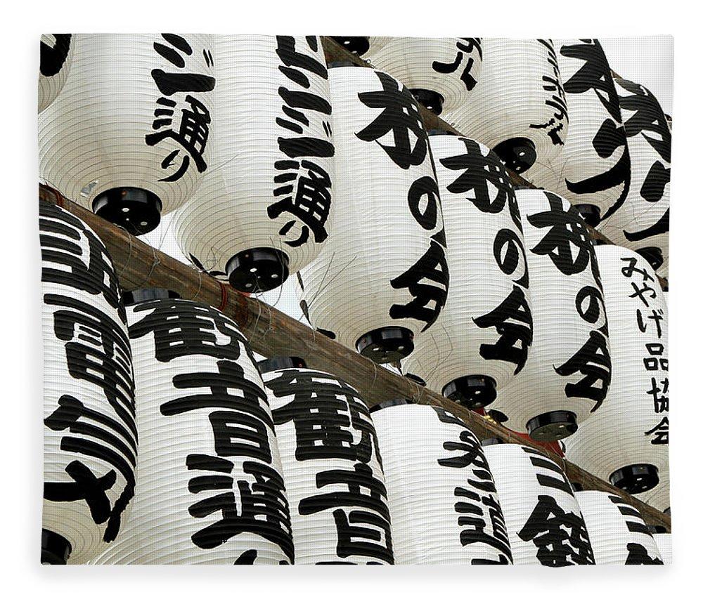 Pole Fleece Blanket featuring the photograph Japanese Paper Lanterns In Preparation by Britta Wendland