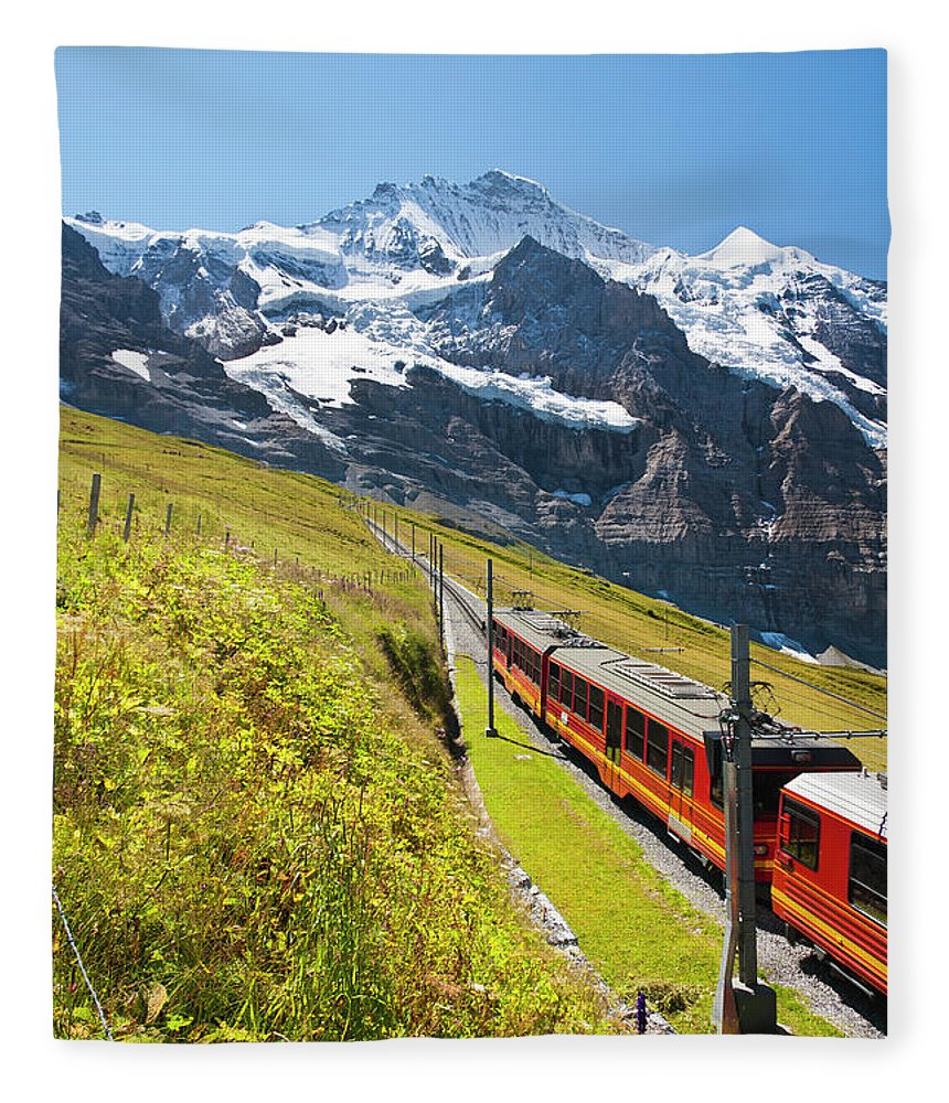 Scenics Fleece Blanket featuring the photograph Jungfraubahn, Swiss Alps by Michaelutech