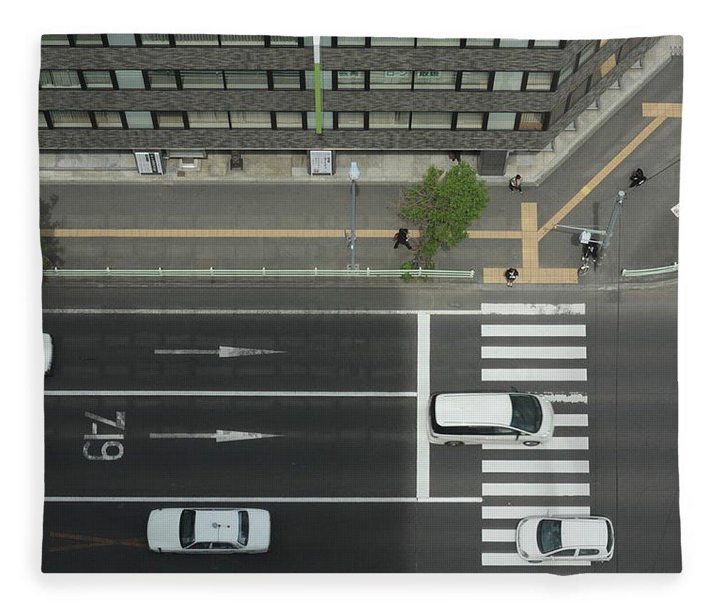 Hokkaido Fleece Blanket featuring the photograph Land Vehicles Crossing Pedestrian by Iyoupapa