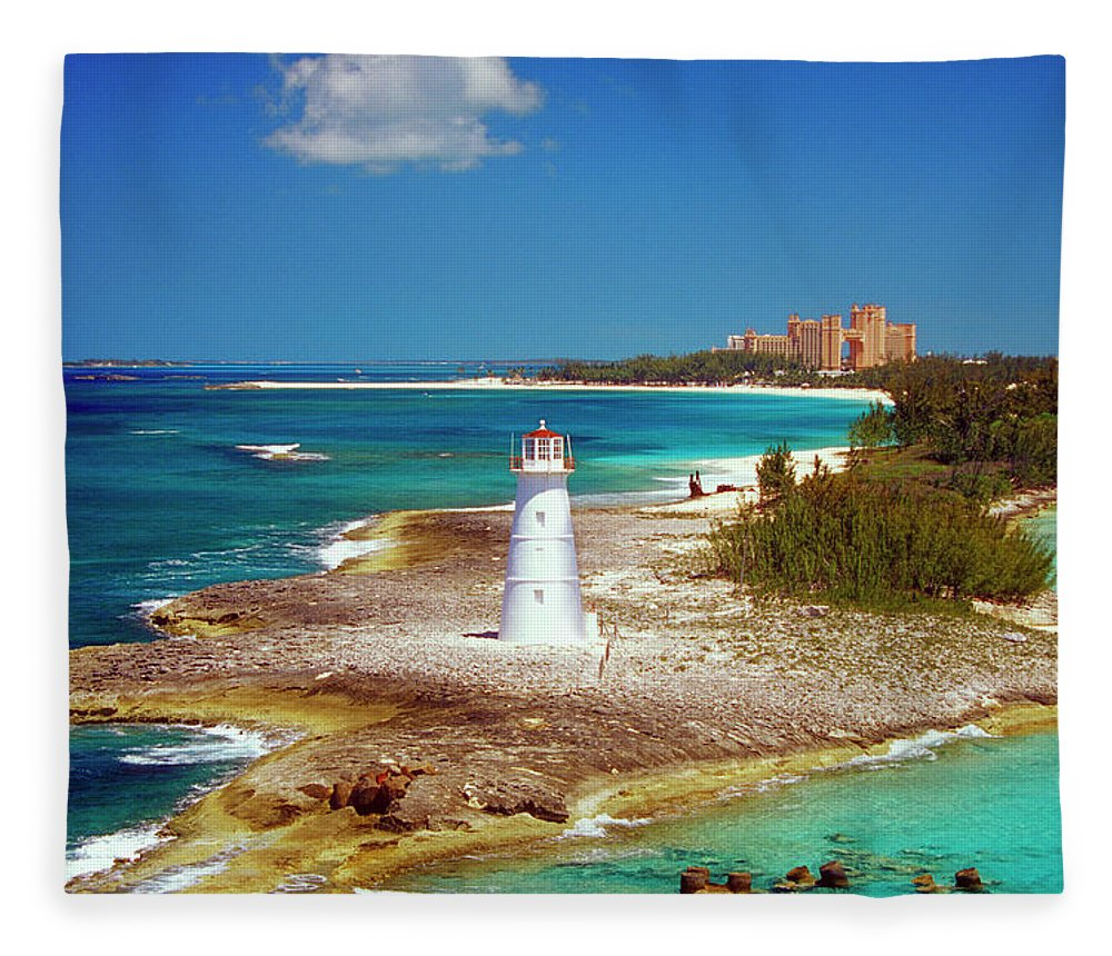 Outdoors Fleece Blanket featuring the photograph Lighthouse On Paradise Island-nassau by Medioimages/photodisc