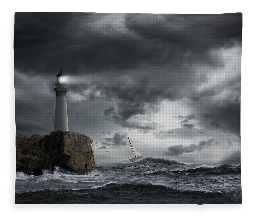 Risk Fleece Blanket featuring the photograph Lighthouse Shining Over Stormy Ocean by John M Lund Photography Inc