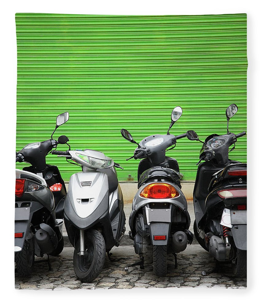 Macao Fleece Blanket featuring the photograph Line Of Motorbikes Against Green by Steven Puetzer