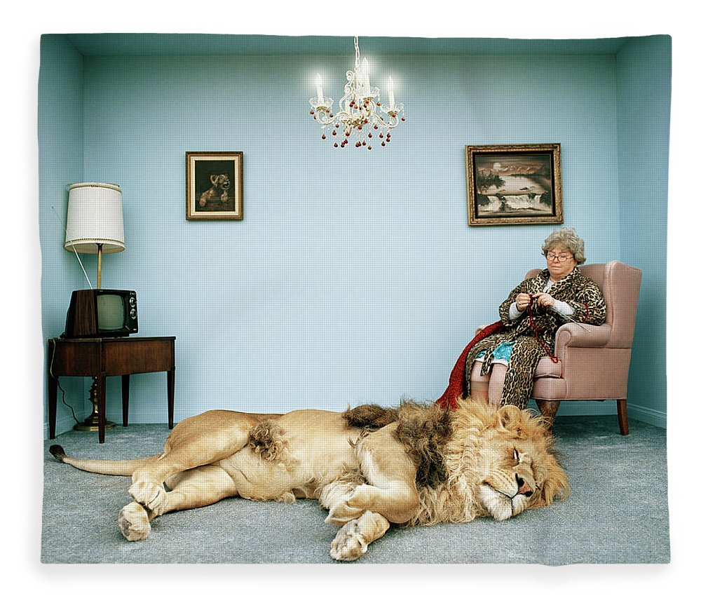 Pets Fleece Blanket featuring the photograph Lion Lying On Rug, Mature Woman Knitting by Matthias Clamer