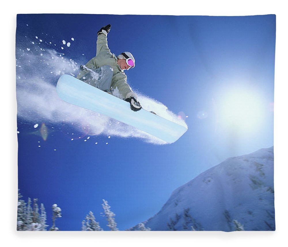 Human Arm Fleece Blanket featuring the photograph Low Angle Mid Air Shot Of A Woman by Digital Vision.
