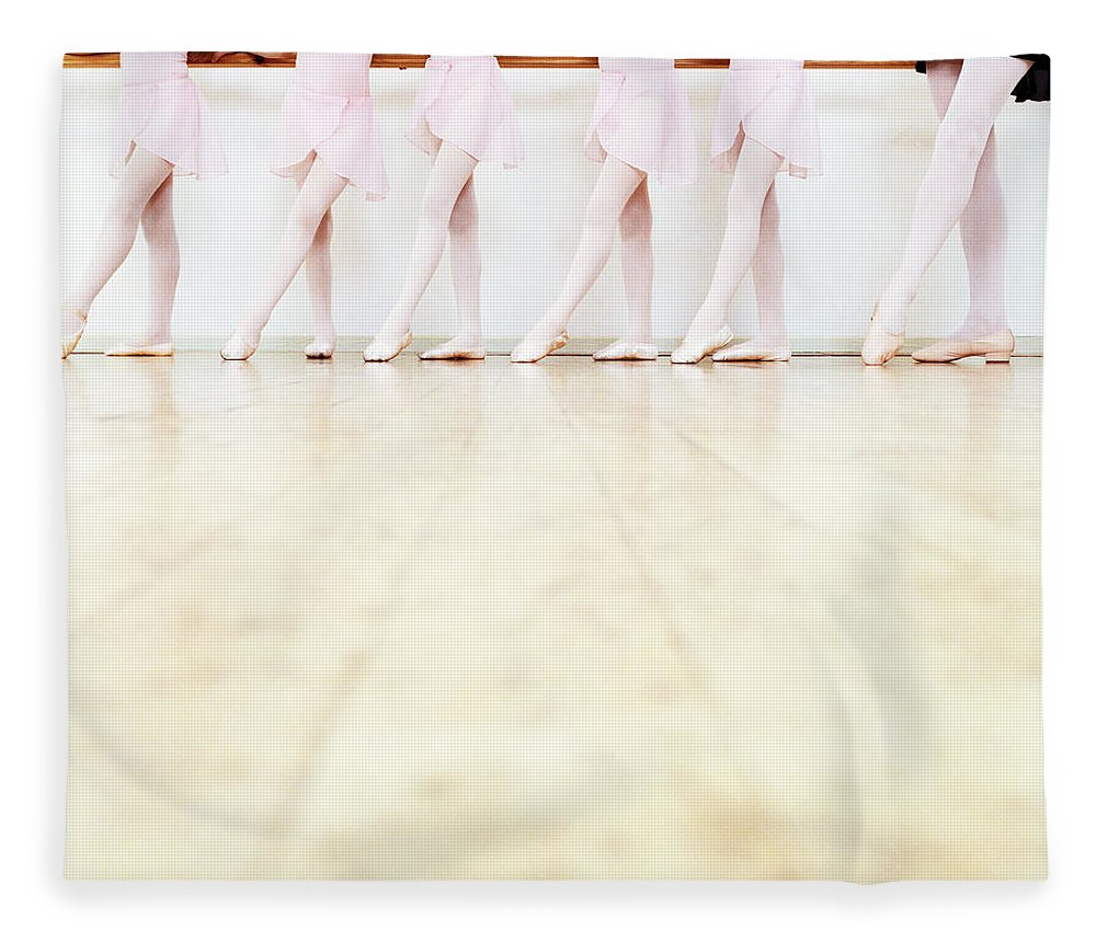 Ballet Dancer Fleece Blanket featuring the photograph Low Section View Of A Line Of Young by Digital Vision.