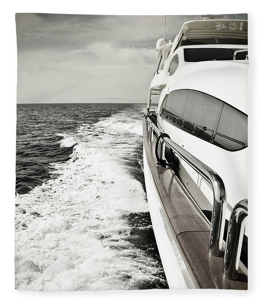 Desaturated Fleece Blanket featuring the photograph Luxury Yacht Sailing At High Speed In by Petreplesea