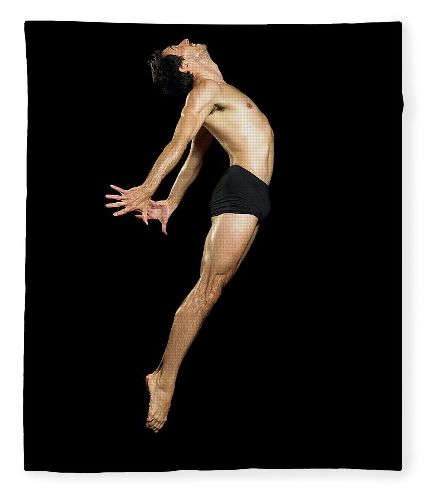 Human Arm Fleece Blanket featuring the photograph Male Dancer Jumping by Image Source