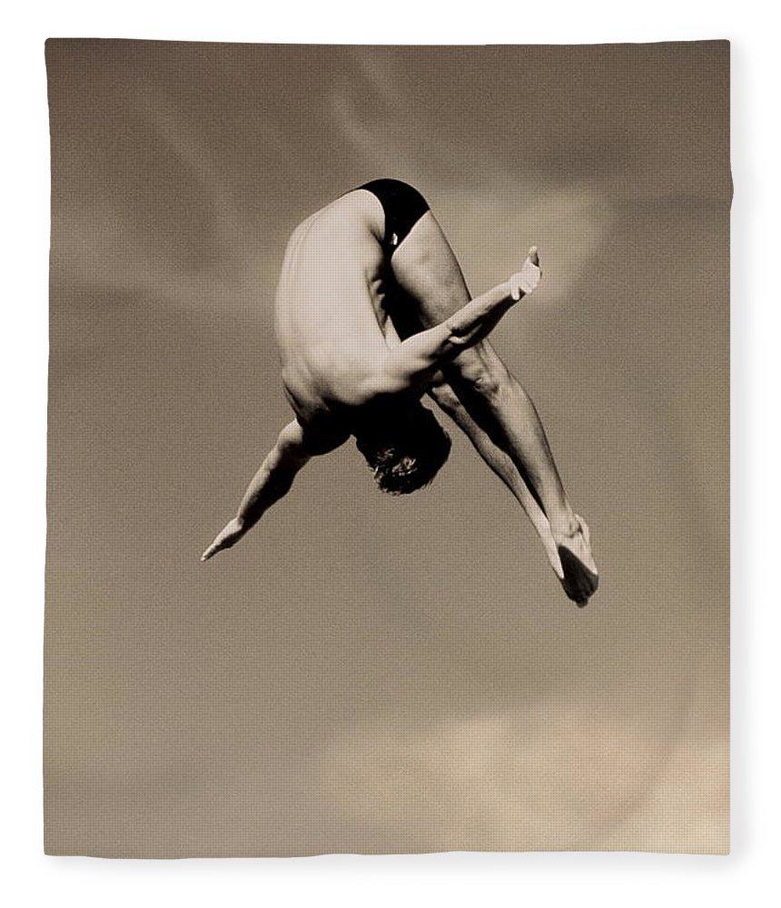 Diving Into Water Fleece Blanket featuring the photograph Male Diver In Mid-air by David Madison