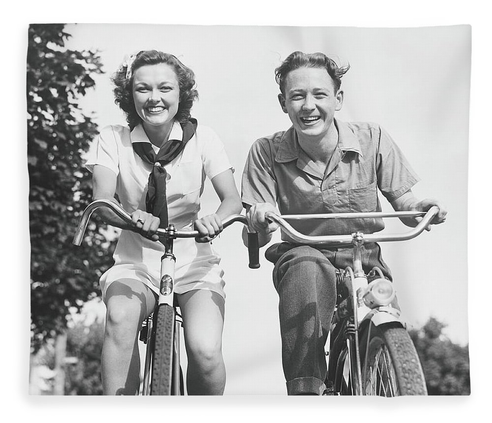 Young Men Fleece Blanket featuring the photograph Man And Woman Riding Bikes, B&w, Low by George Marks