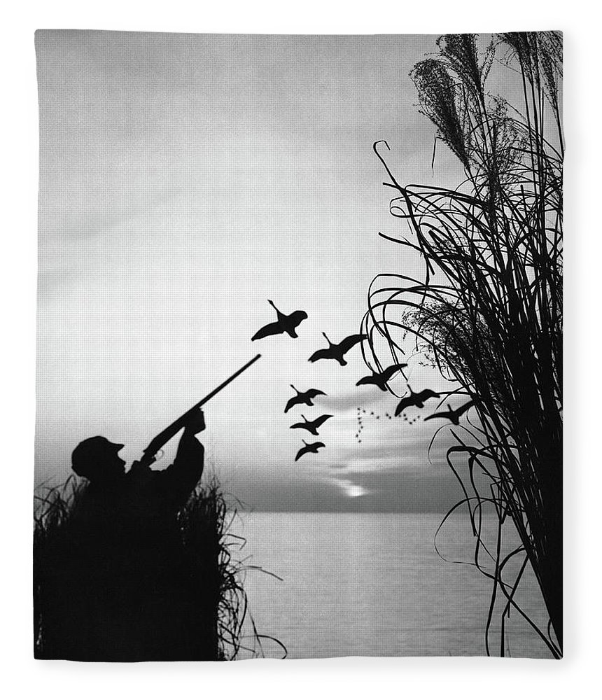 Rifle Fleece Blanket featuring the photograph Man Duck-hunting by Stockbyte