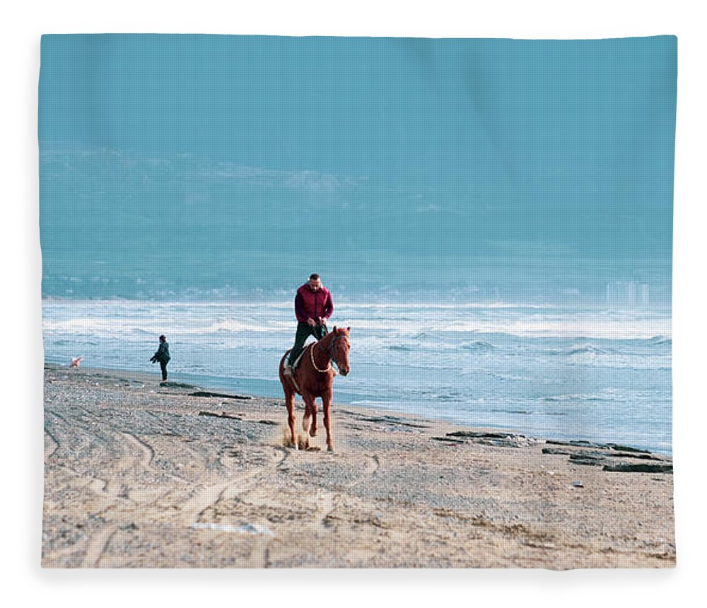 Akdeniz Fleece Blanket featuring the photograph Man Riding On A Brown Galloping Horse On Ayia Erini Beach In Cyp by Iordanis Pallikaras
