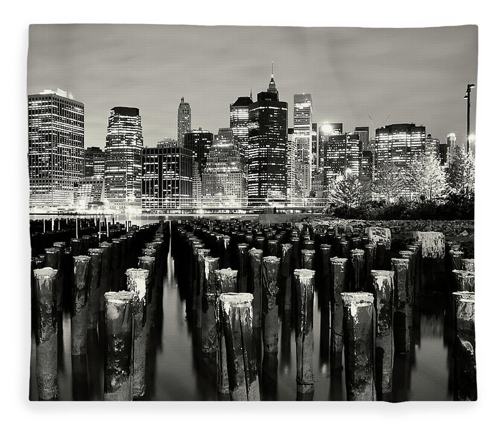Wooden Post Fleece Blanket featuring the photograph Manhattan At Night by Shobeir Ansari