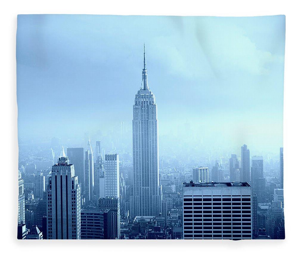 Lower Manhattan Fleece Blanket featuring the photograph Manhattan Skyline In The Fog, Nyc. Blue by Lisa-blue