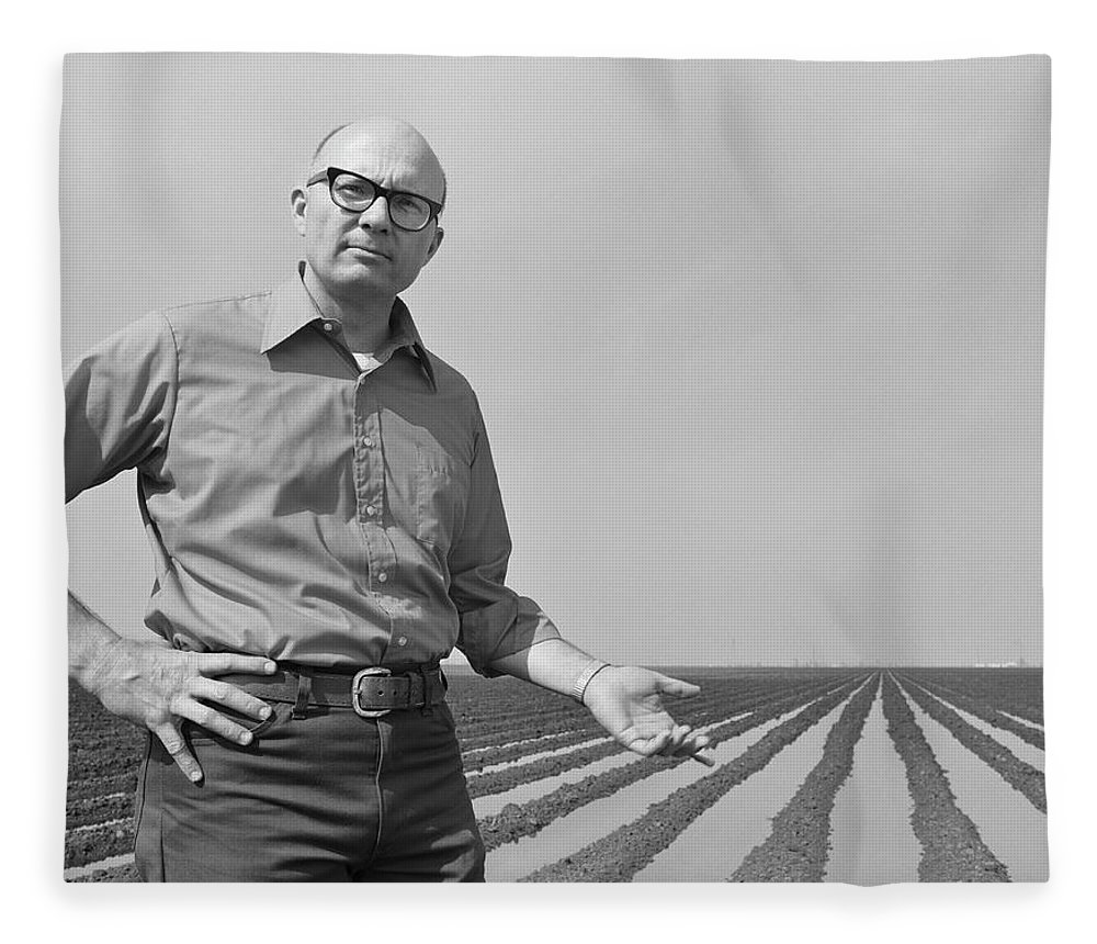 Mature Adult Fleece Blanket featuring the photograph Mature Man Gesturing At Ploughed Field by Tom Kelley Archive
