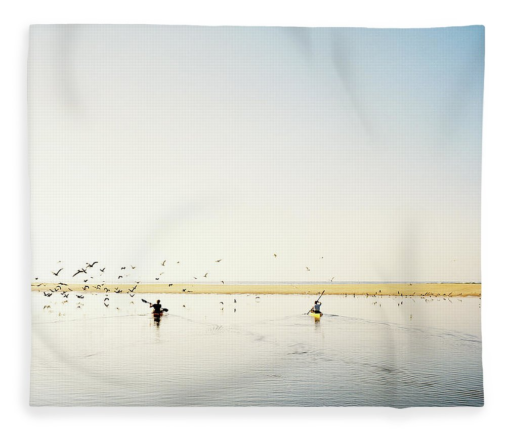 People Fleece Blanket featuring the photograph Men Paddling Kayaks To The Beach by Julien Capmeil