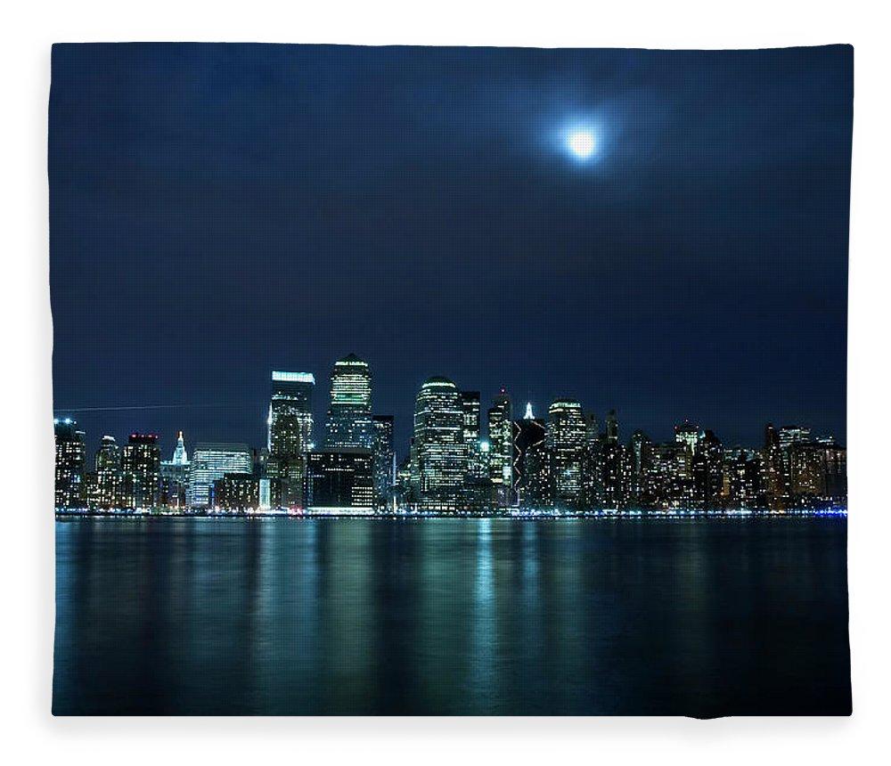 Lower Manhattan Fleece Blanket featuring the photograph Moon Light Over New York City by Brandonj74
