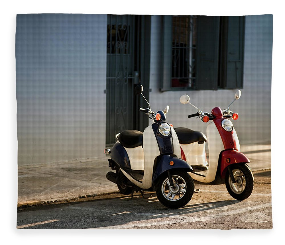 In A Row Fleece Blanket featuring the photograph Motorbikes Parked On The Road by Pgiam