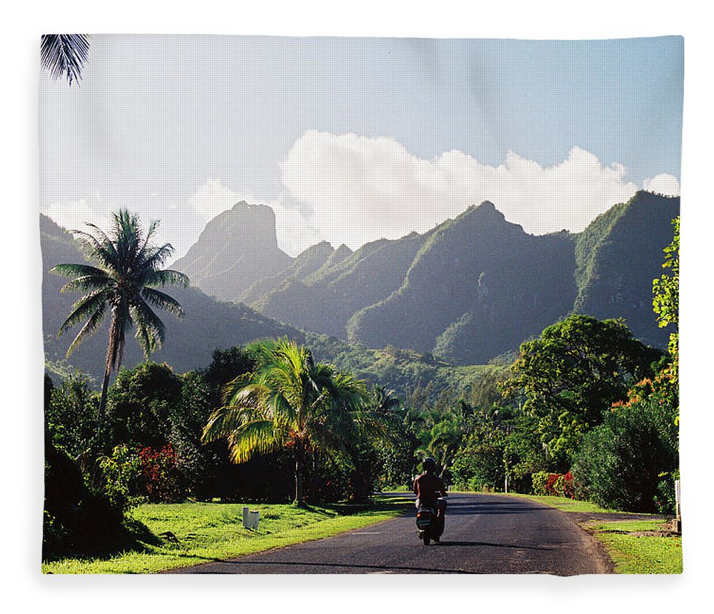Shadow Fleece Blanket featuring the photograph Motorcyclist On Polynesian Road by Ejs9
