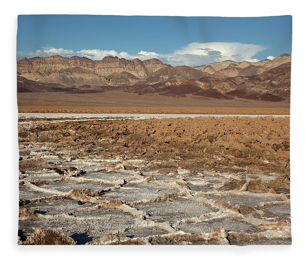 Badlands Fleece Blanket featuring the photograph Muddy Salt Flats And Black Mountains by Milehightraveler