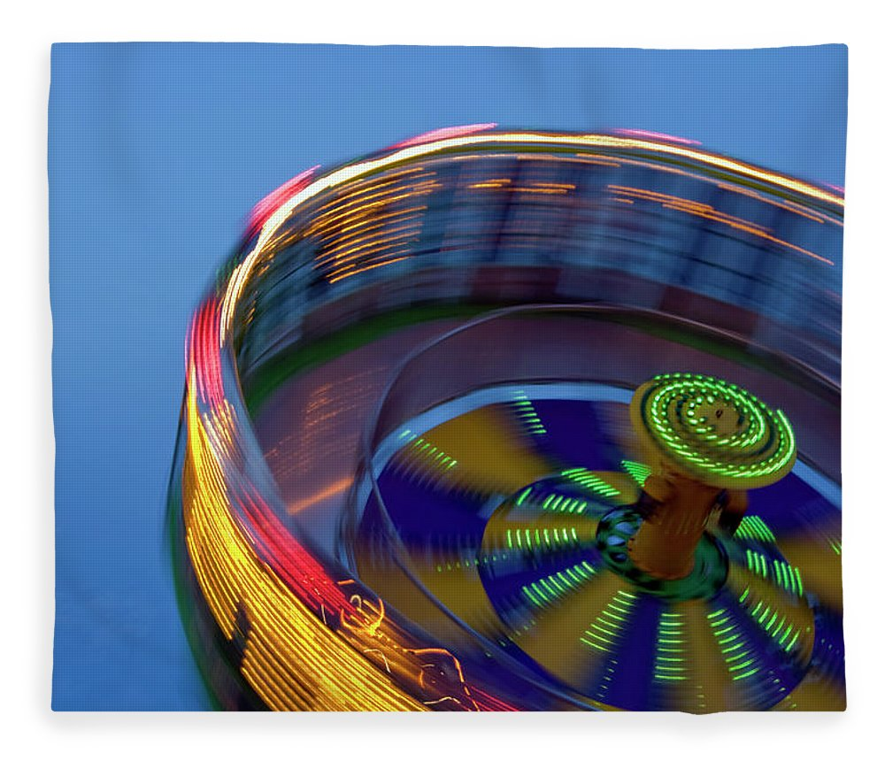 Carousel Fleece Blanket featuring the photograph Multicolored Spinning Carnival Ride by By Ken Ilio