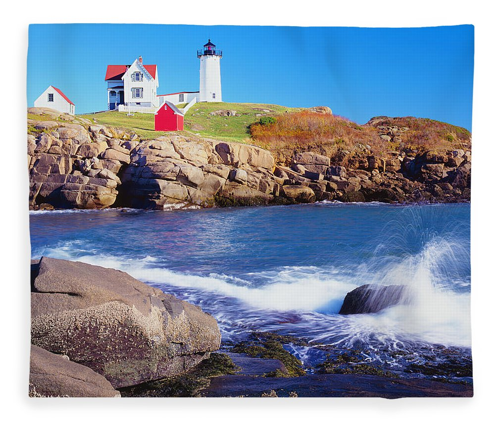 Water's Edge Fleece Blanket featuring the photograph Nubble Lighthouse And Coastine Of Maine by Ron thomas