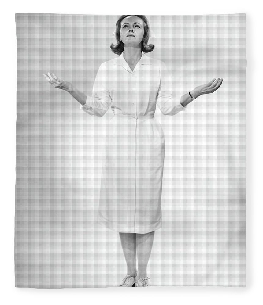Human Arm Fleece Blanket featuring the photograph Nurse Gesturing In Studio, B&w by George Marks