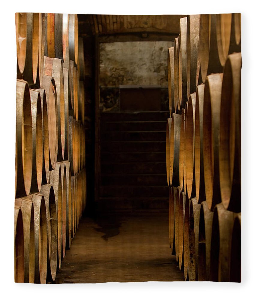 Alcohol Fleece Blanket featuring the photograph Oak Barrels At The Wine Cellar by Kycstudio