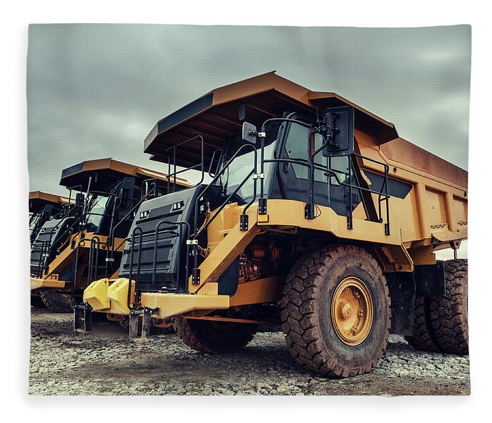 Construction Machinery Fleece Blanket featuring the photograph Off-highway Dump Trucks by Shaunl