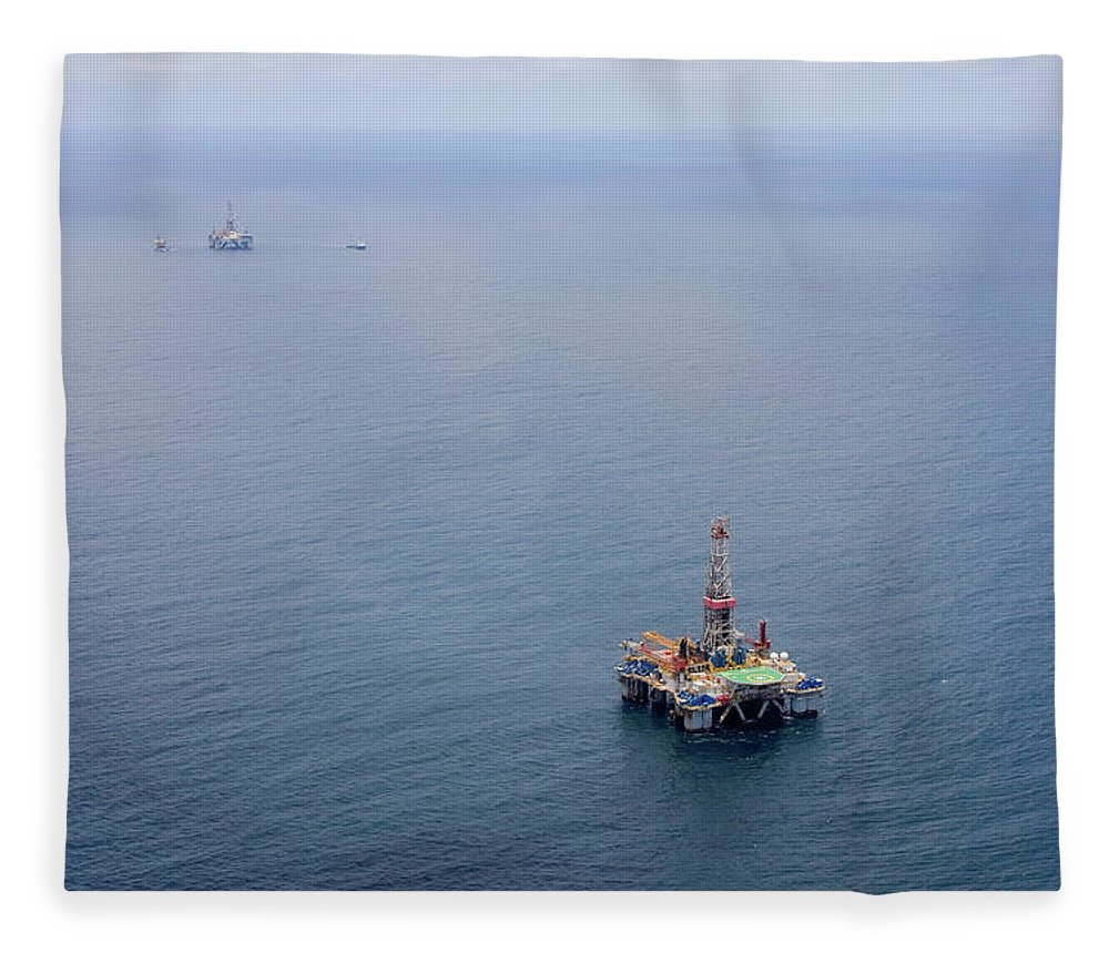 Convoy Fleece Blanket featuring the photograph Oil Rigs by Heliry