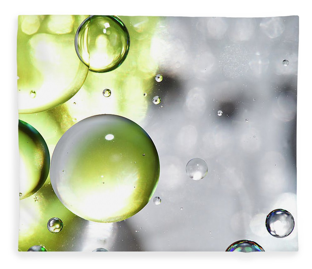 Mixing Fleece Blanket featuring the photograph Oil Spheres by Dovate