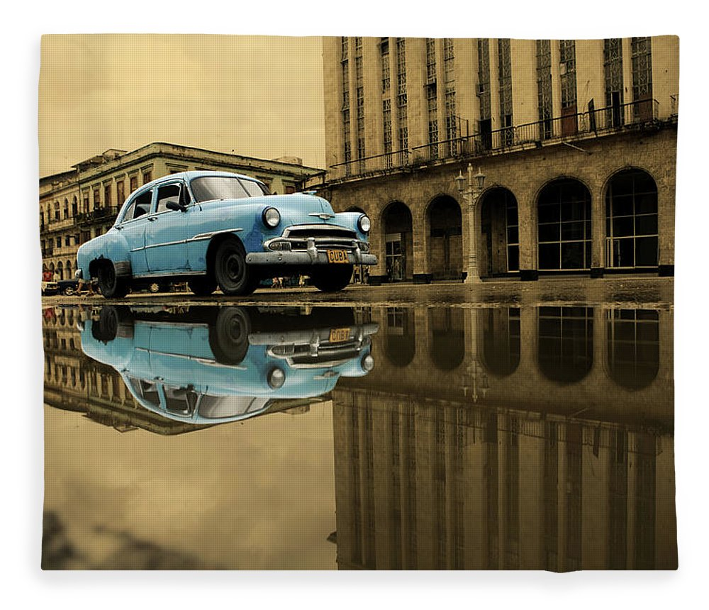 Arch Fleece Blanket featuring the photograph Old Blue Car In Havana by 1001nights