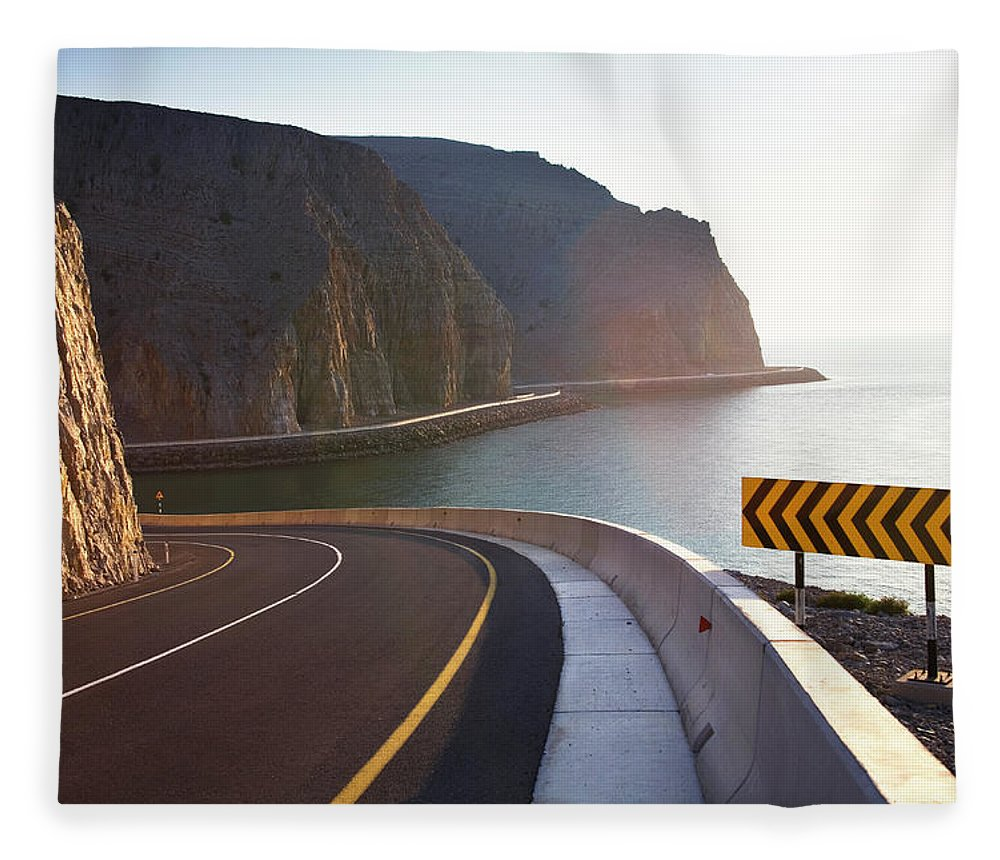 Curve Fleece Blanket featuring the photograph Oman, Khasab, Road Round Mountain By by Christian Adams