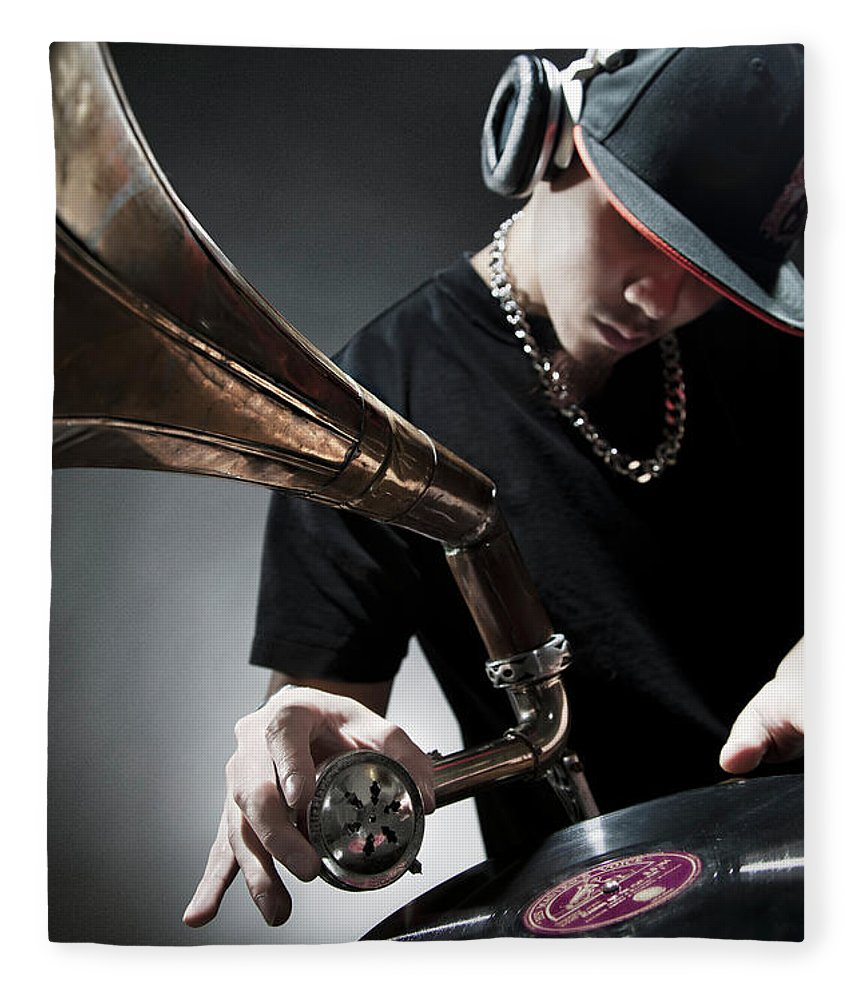Youth Culture Fleece Blanket featuring the photograph Oriental Dj Using Old Gramophone To Mix by Justin Lambert